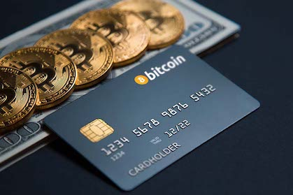 credit card and 100$ bills and 5 bitcoin expressing that bitcoin debit card are ready to use