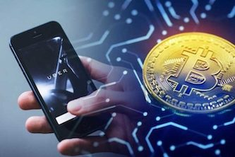 young crypto investor ready to deposit bitcoin on his smartphone uber app