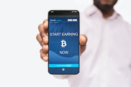 """middle aged and black crypto investor holding a smartphone saying """"start earning bitcoin today"""""""