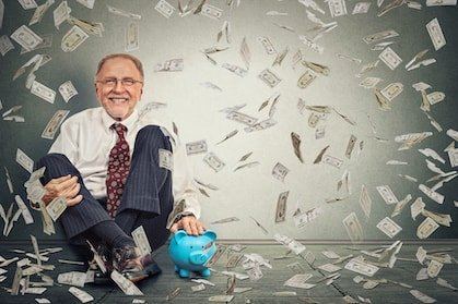 old crypto investor sitting on the floor and smiling under a 100$ bills rain